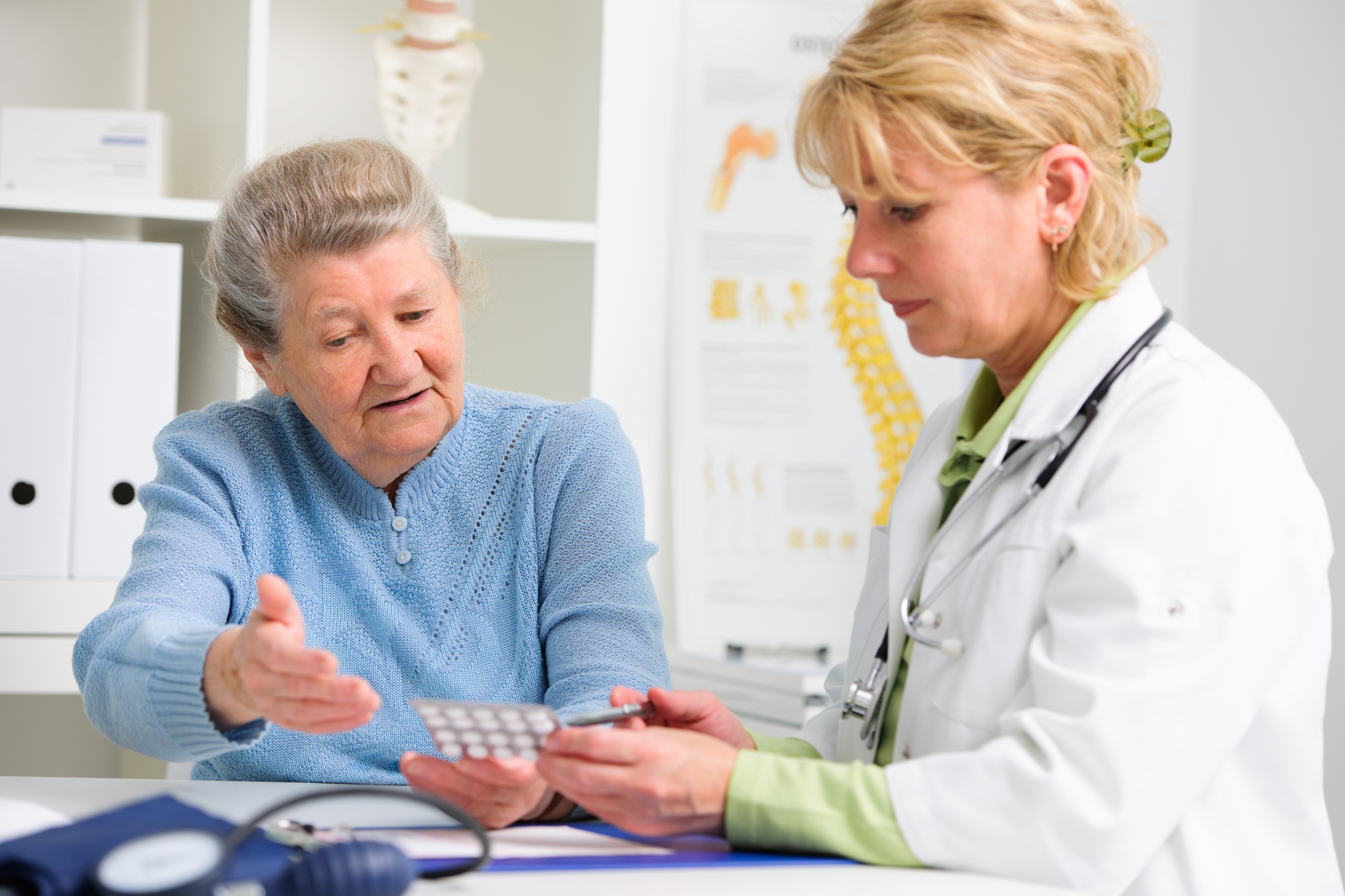 Woman discussing medication with pharmacist